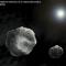 Rappresentazione artistica di un asteroide binario (NASA)